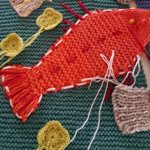 brightly coloured knitted fish